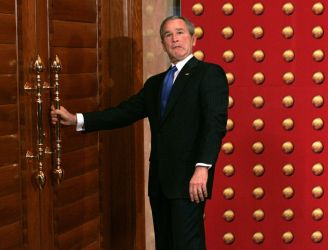 Former President Bush, seen here, attempting to exit through a door to no where.